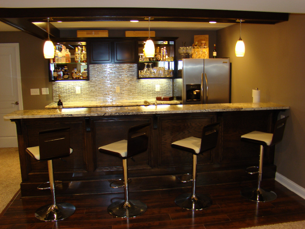 beautiful tile and granite bar in newly finished basement