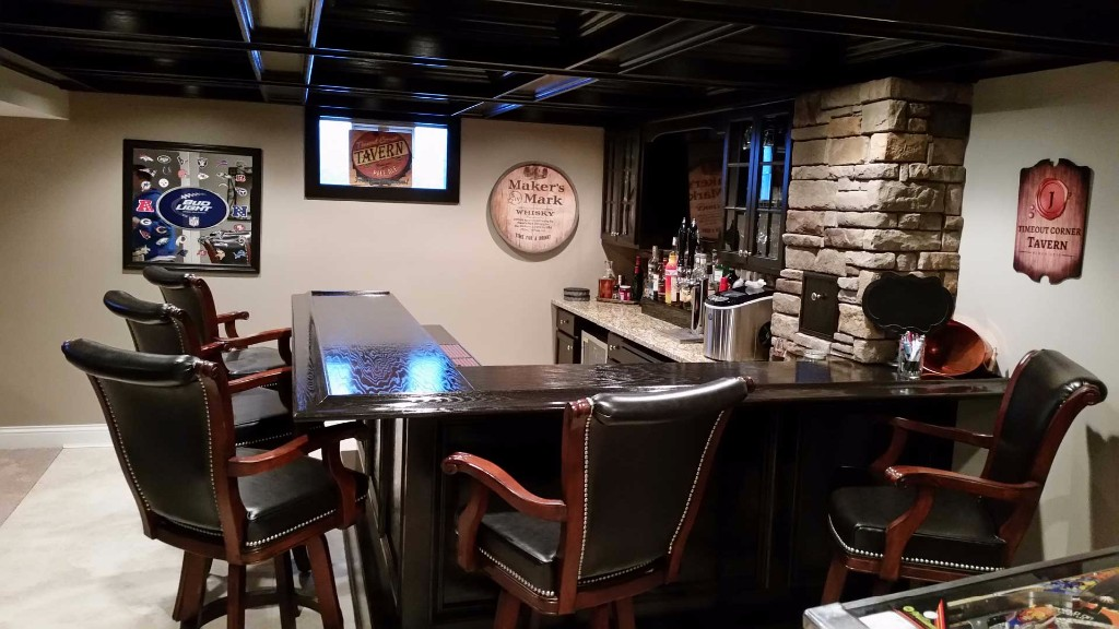 Custom built basement bar with stone accents