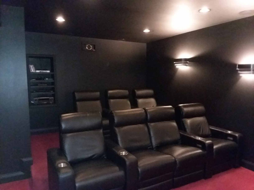custom home theater with luxury seating